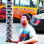 Man holding a tower of baoding balls