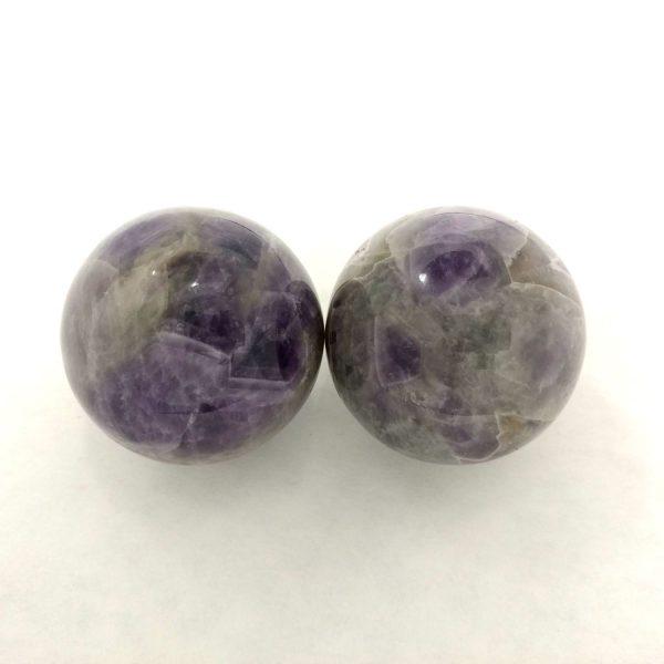Baoding balls made from amethyst gemstone