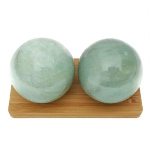 Green aventurine baoding balls on a display stand