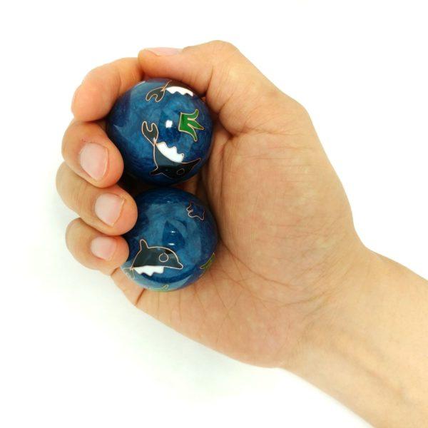 Hand holding medium size baoding balls