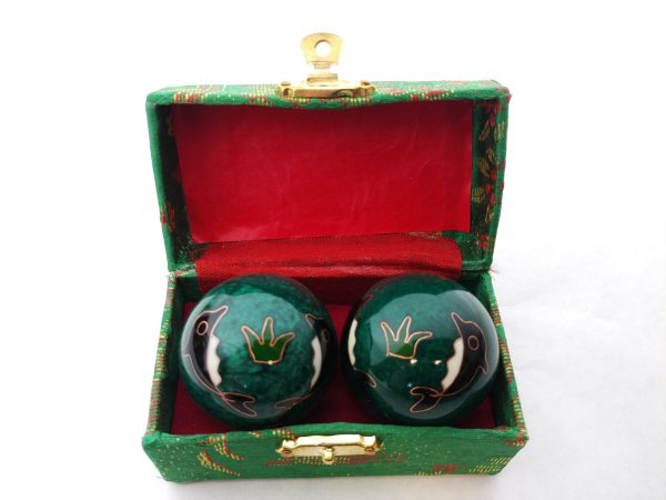 Green baoding balls withe dolphin designs in a box