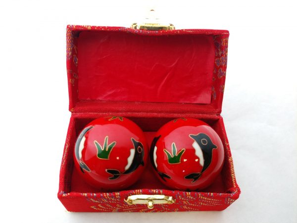 Red baoding balls with dolphin designs in a box