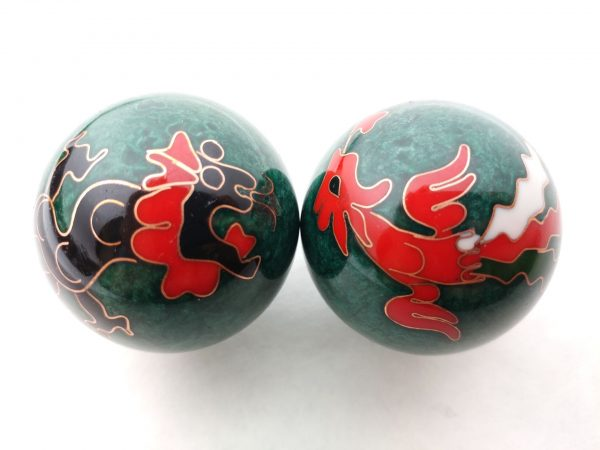 Green baoding balls with dragon and phoenix designs