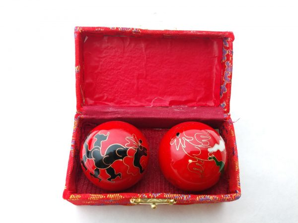 Red baoding balls with dragon and phoenix designs in a box