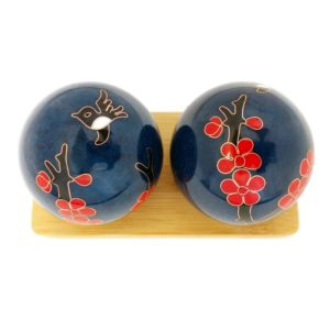 Hummingbird baoding balls on a display stand