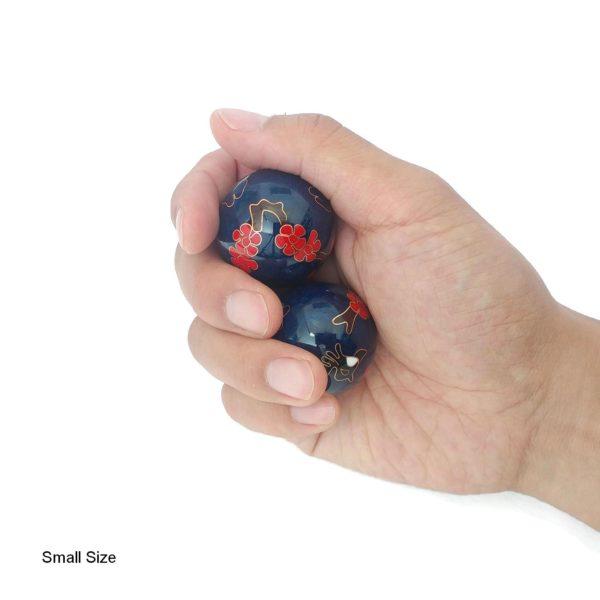 Hand holding hummingbird baoding balls