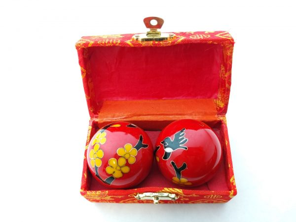 Red baoding balls with humming bird design in a box