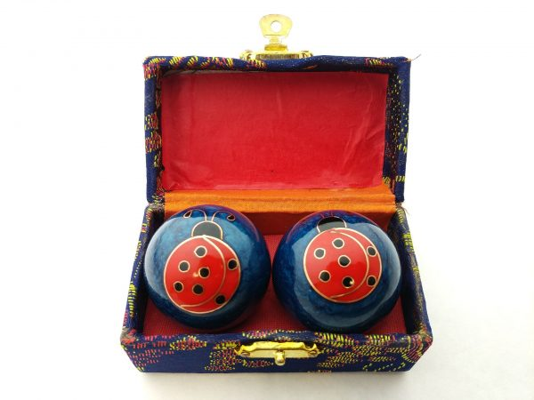 Blue baoding balls with ladybug design in a box
