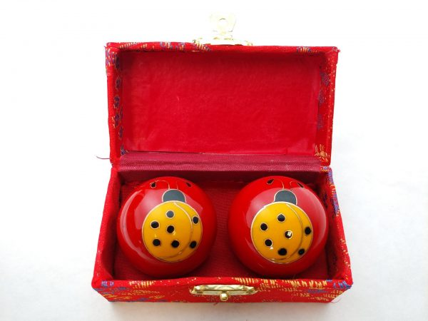 Red baoding balls with ladybug design in a box