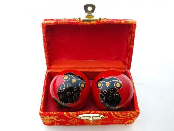Red baoding balls with owl design in a box