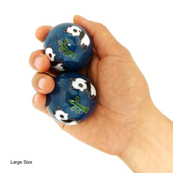 Hand holding large panda baoding balls