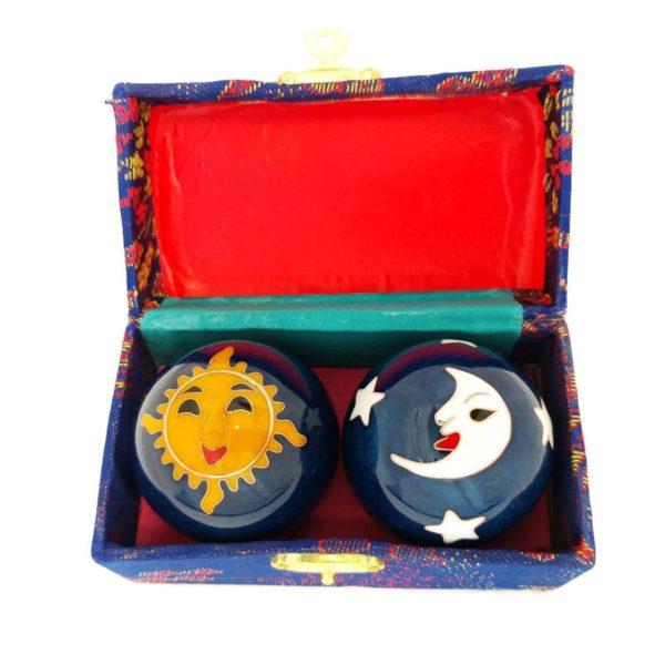 Blue sun and moon baoding balls in a box.