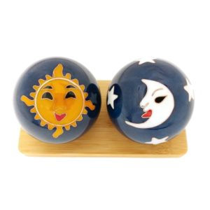 Sun and moon baoding balls on a display stand