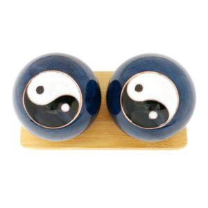 Yin Yang baoding balls on display stand