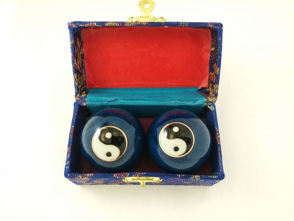 Blue baoding balls with yin yang design in a box
