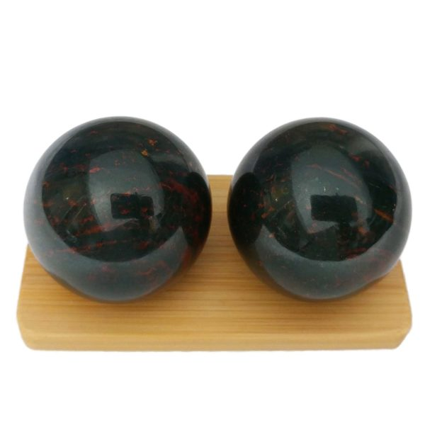 Bloodstone baoding balls on a bamboo stand