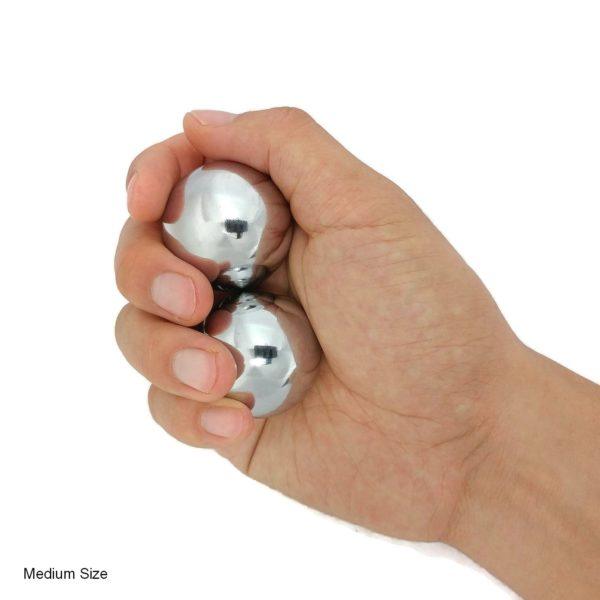 Hand holding chrome baoding balls