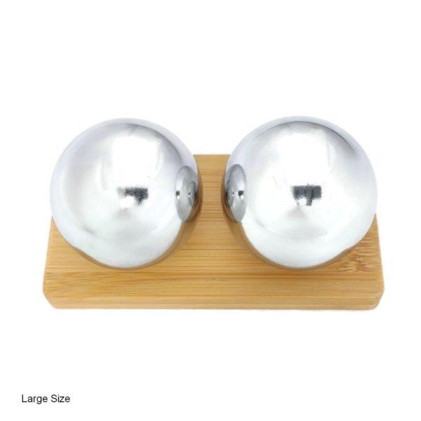 Chrome baoding balls on bamboo stand
