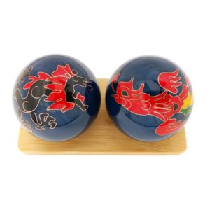 Dragon and Phoenix baoding balls on a display stand