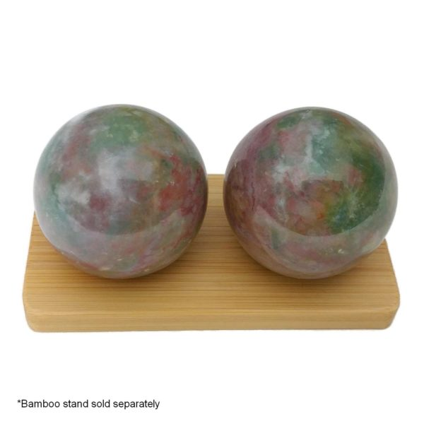 Fancy jasper baoding balls on a bamboo display stand