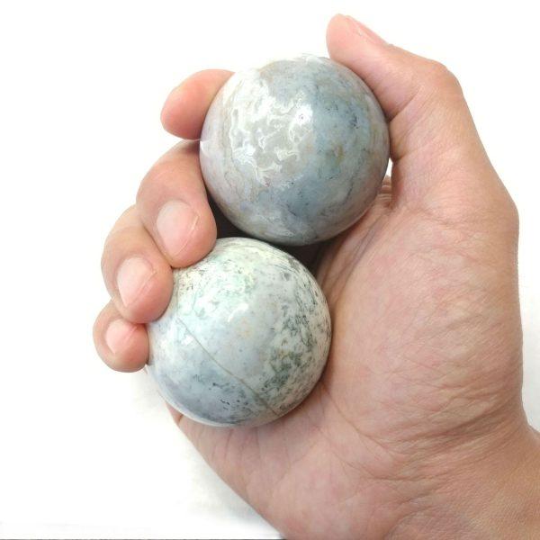 Hand holding large fancy jasper baoding balls