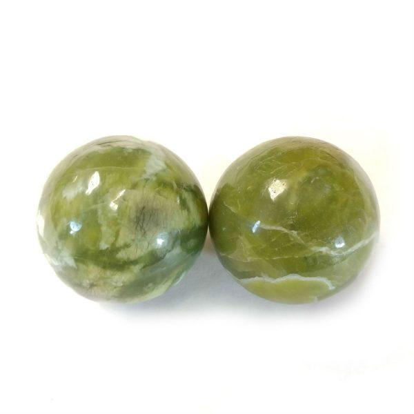 Baoding balls made from green jade gemstone