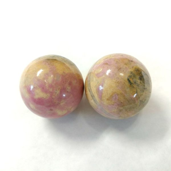 Baoding balls made from rhodonite gemstone