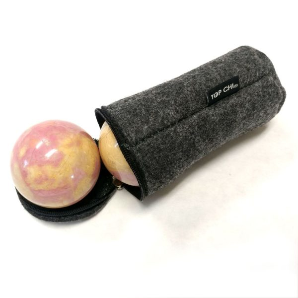 Baoding balls made from rhodonite gemstone in a carry bag