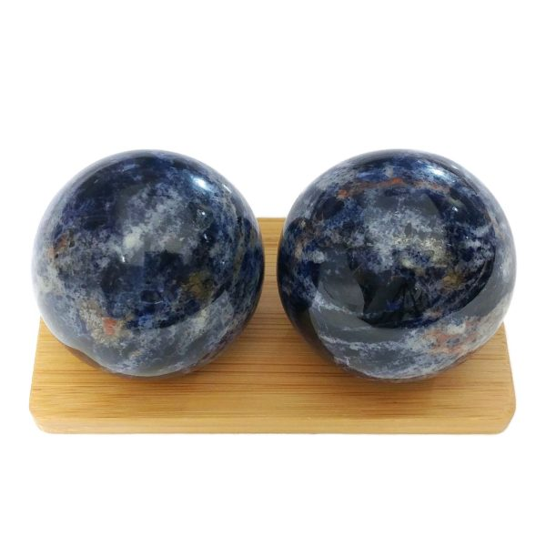 Sodalite baoding balls on a display stand