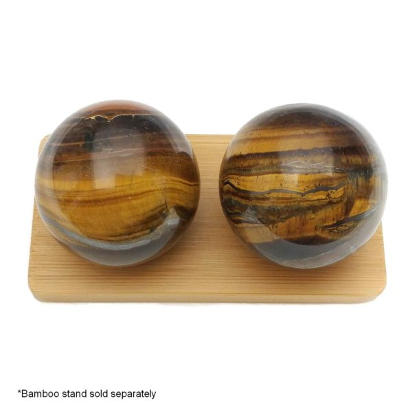 Tigers eye baoding balls on a display stand