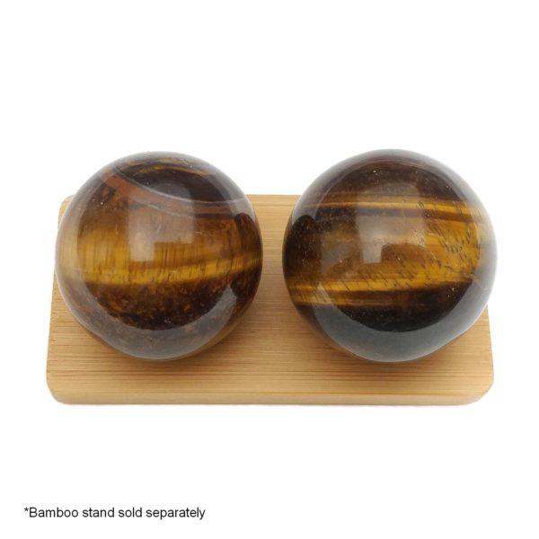 Tigers eye baoding balls on a display stand