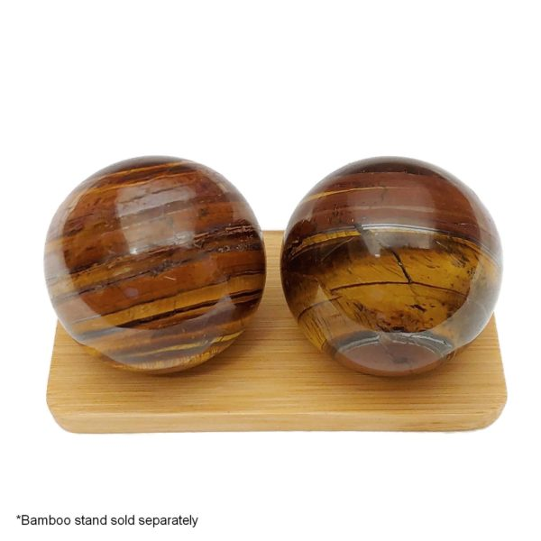 Tiger iron baoding balls on a bamboo display stand