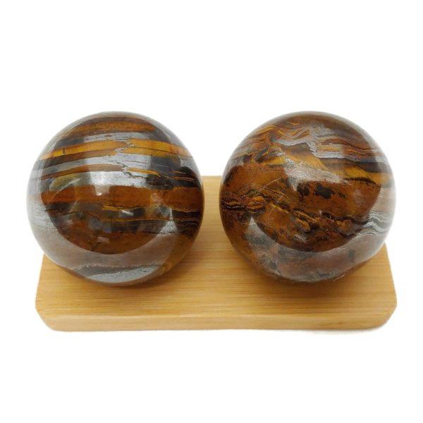 Tiger iron baoding balls on a bamboo display stand