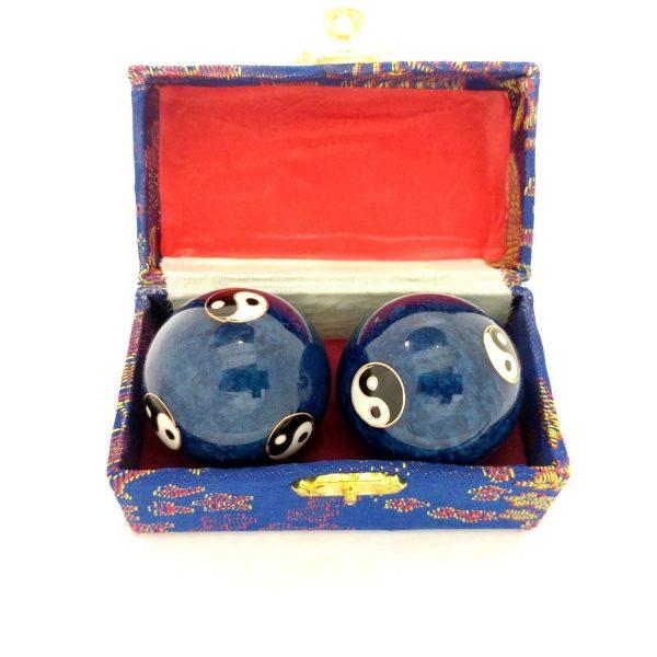 Blue yin yang baoding balls in a box