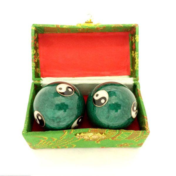 Green baoding balls with yin yang design in a box
