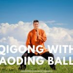 Man doing qigong with text Qigong with Baoding Balls