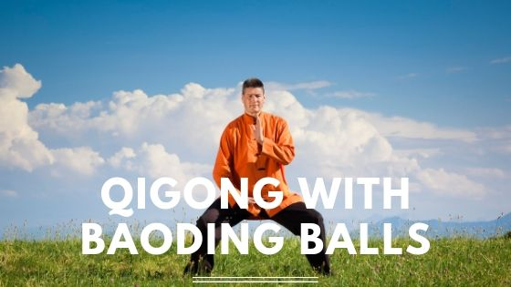 Man doing qigong with text Qigong with Baoding Balls