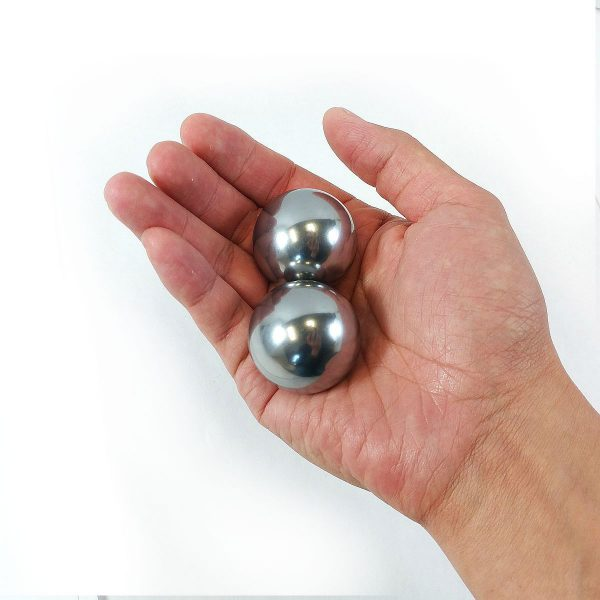 "Hand holding 1.5"" solid stainless steel baoding balls"