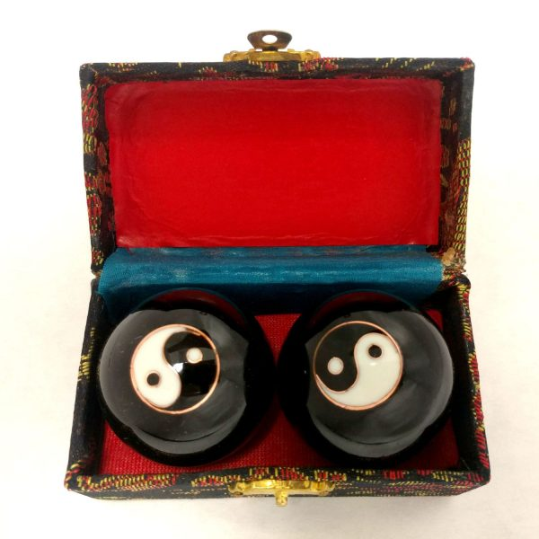 Black baoding balls with yin yang design in a box