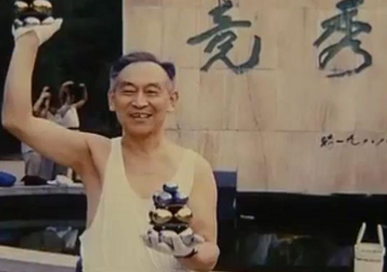 Li Zhanchun holding two iron ball towers when he was younger