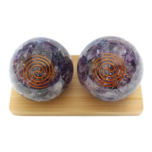 Large amethyst orgonite baoding balls on display stand