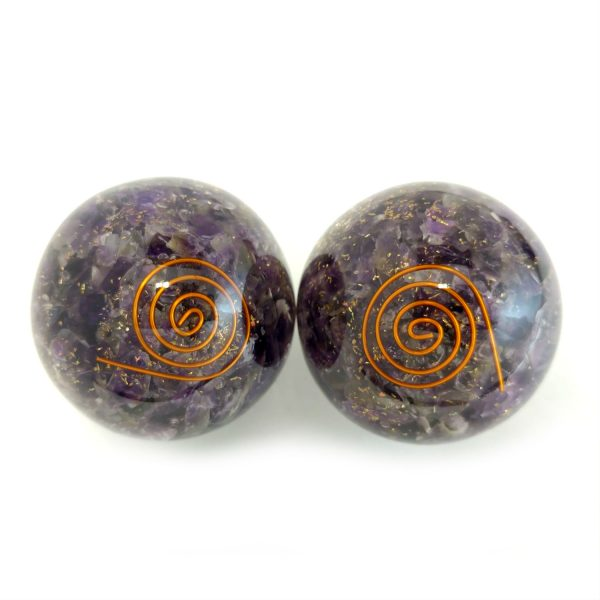 Two amethyst orgonite baoding balls with coil designs