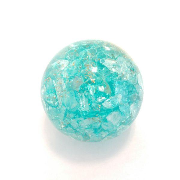Single aquamarine orgonite ball showing the back
