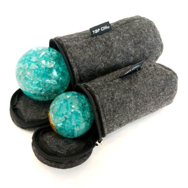 Large and medium aquamarine orgonite baoding balls next to each other