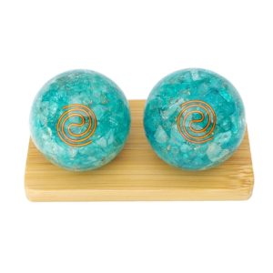 Aquamarine quartz orgonite baoding balls on display stand