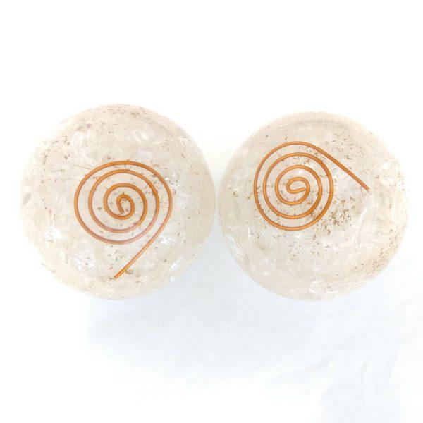 Two quartz orgonite baoding balls with copper spiral designs