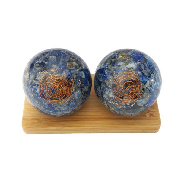 Lapis lazuli orgonite baoding balls on a display stand