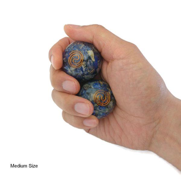 Hand holding lapis lazuli orgonite baoding balls