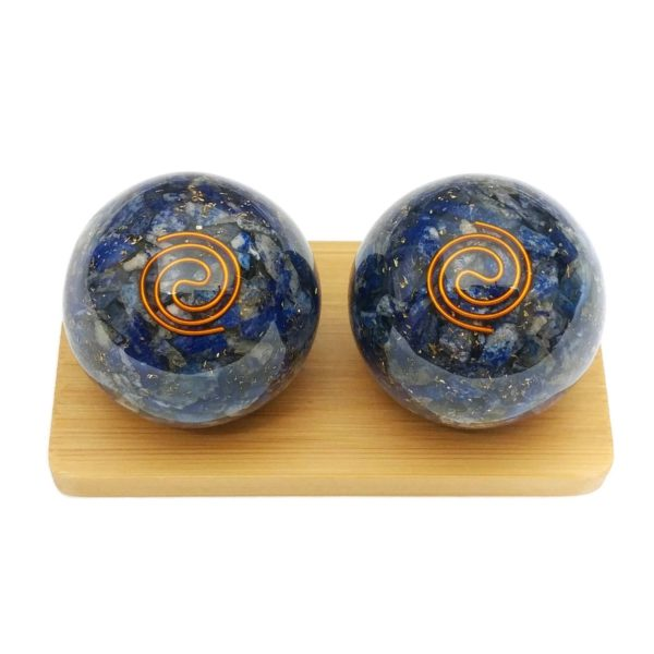 Lapis lazuli orgonite baoding balls on a display stand