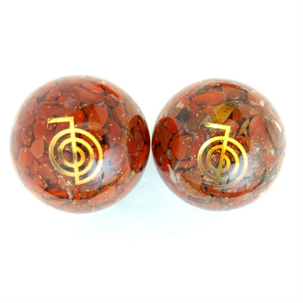 Two red jasper orgonite baoding balls with reiki power designs